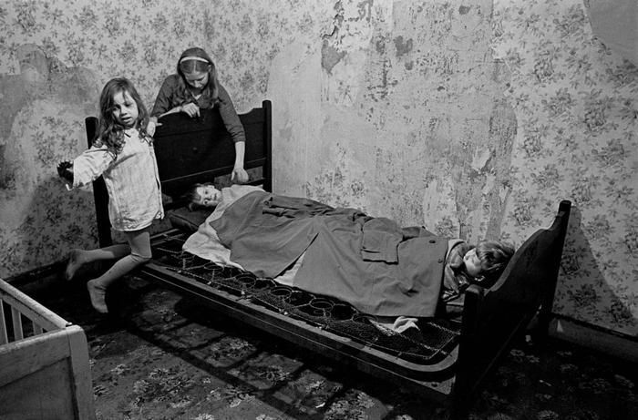 Mrs Milne putting her children to bed Balsall Heath 1968