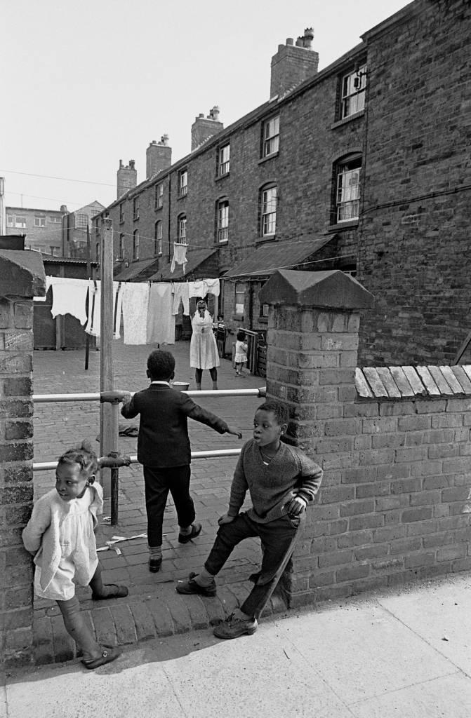 Children by back courtyard of their Aston home, 1969