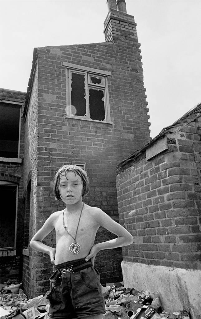 Young girl playing by derelict property 1969