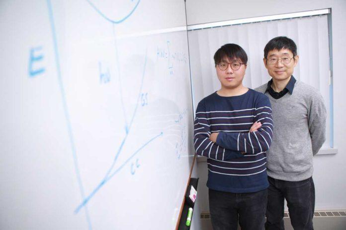 Dr. Xiaoming Wang, left, and Dr. Yanfa Yan, right