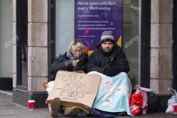 homeless-couple-begging-on-the-streets-of-london-charing-cross-england-EGD80B