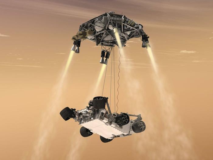 Так, по мнению НАСА, должен был выглядеть спуск марсохода после отделения от парашюта. Вверху - реактивно-тормозная установка, внизу - марсоход.