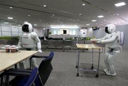 Корпорация Honda научила своих роботов Asimo работать парами