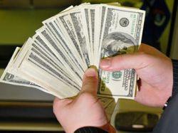 Минфин пока не будет покупать валюту, чтобы не вредить рублю