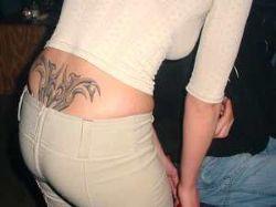 Новость на Newsland: В России женщинам могут запретить делать татуировки на пояснице