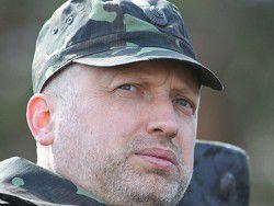 СМИ сообщили об обстреле бронеавтомобиля Турчинова