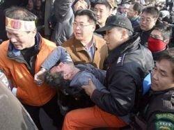 Из-за разлива нефти корейский рыботорговец Чжи Чхан Хван выпил яд и поджег себя
