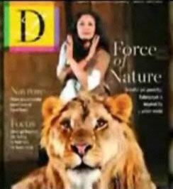Лев напал на женщину во время фотосъемки для журнала (видео)