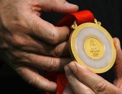 Представлены комплекты медалей Олимпиады-2008