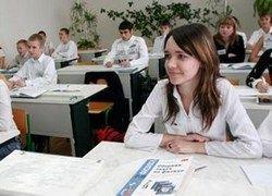 Медведев предлагает сделать электронными школьные дневники