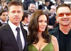 Анджелина Джоли и Брэд Питт зовут Боно в крестные своих близнецов
