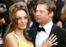 Джоли и Питт продали фото своих детей за $11 млн