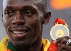 Усейн Болт стал трехкратным олимпийским чемпионом