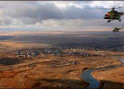 Космонавты и турист приземлились в Казахстане