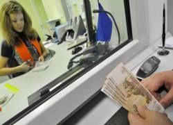 Официальный курс доллара опустился ниже 36 рублей