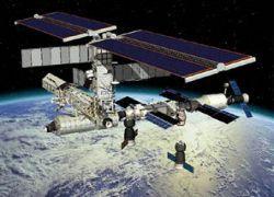 Шаттл Discovery заснял на видео МКС
