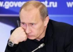 Коммунисты требуют убрать с плакатов Путина