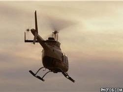 Вертолет на юге Киргизии разбрасывает листовки с призывами к миру