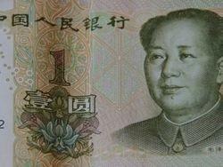 Китай позволит курсу юаня снизиться