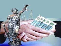 Разбросавшим взятку чиновникам грозят 12 лет тюрьмы