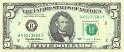 Банкнота достоинством в 5 долларов США меняет цвет