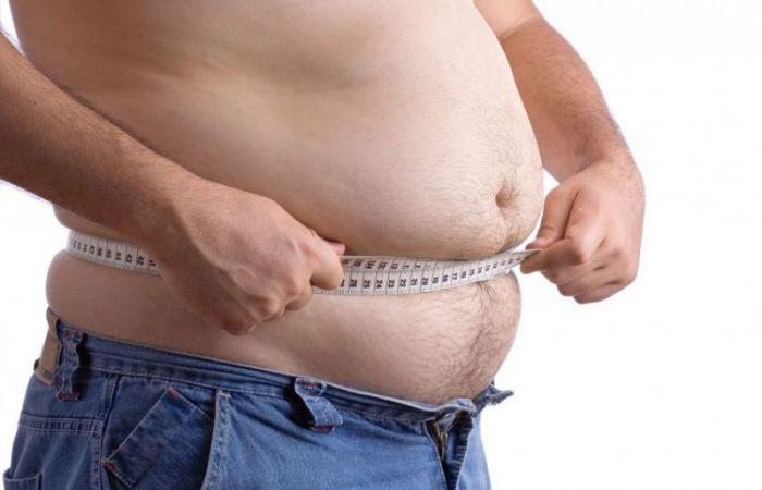 Большой живот у мужчин причины